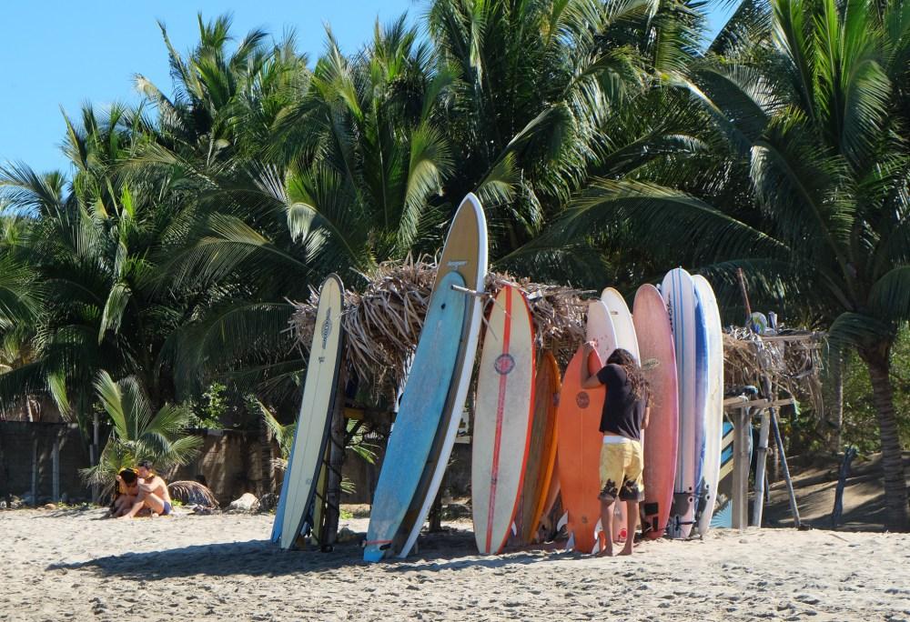 Tending his surfboards