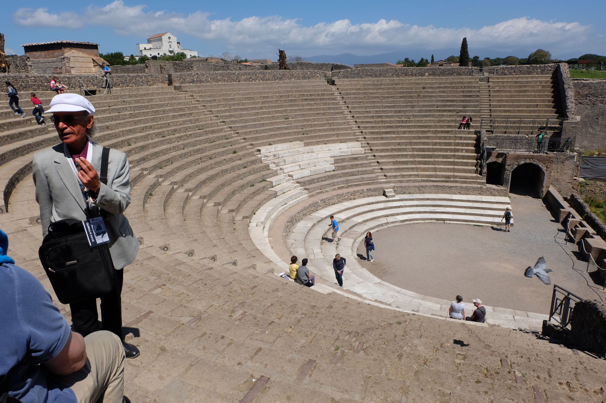 Our guide telling us about the theatre in Pompeii
