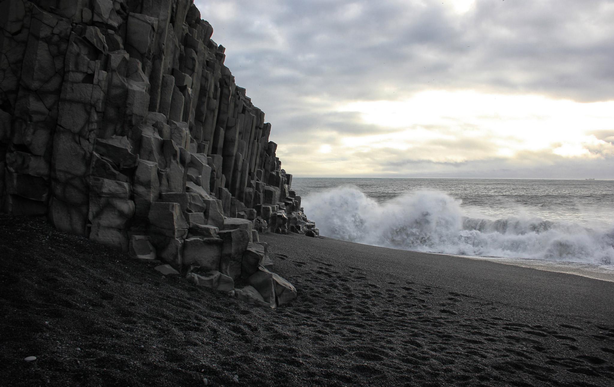The waves crashing against the basalt cliffs at Vik