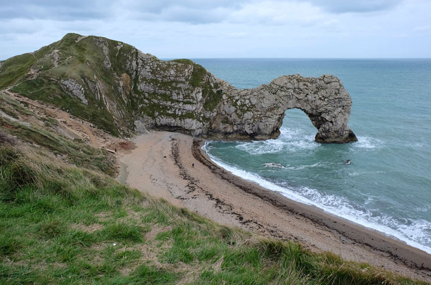The Durdle Door arch (with a person for scale)