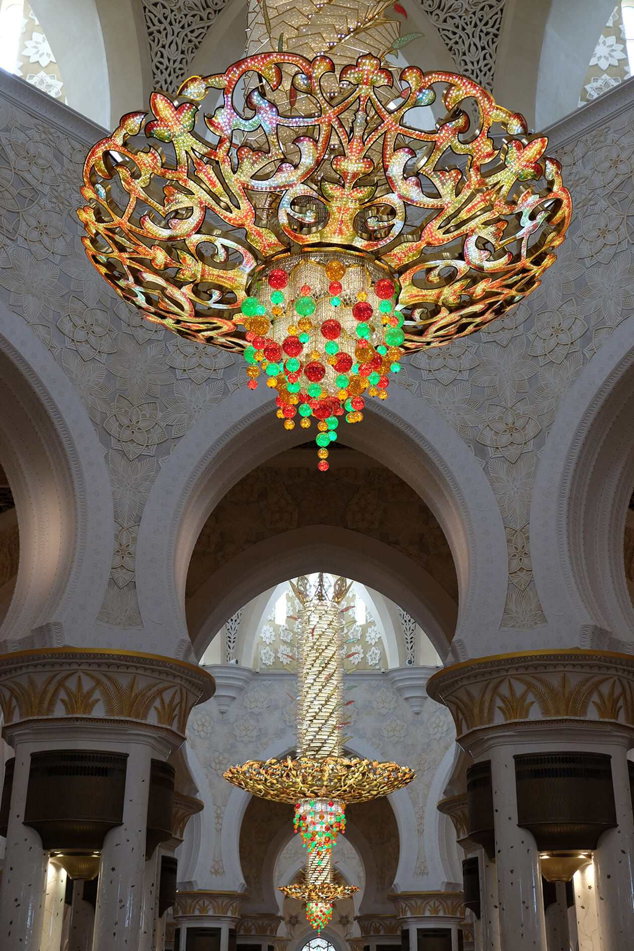The chandeliers are some of the largest in a mosque. The biggest one weighs 12 tons.