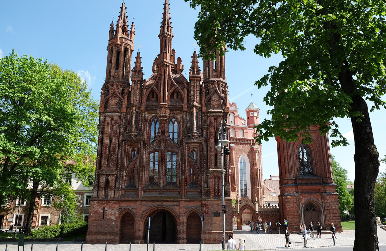 """The two brick churches and their shared bell tower. Locals call the trio """"two swans and an ugly duckling'"""