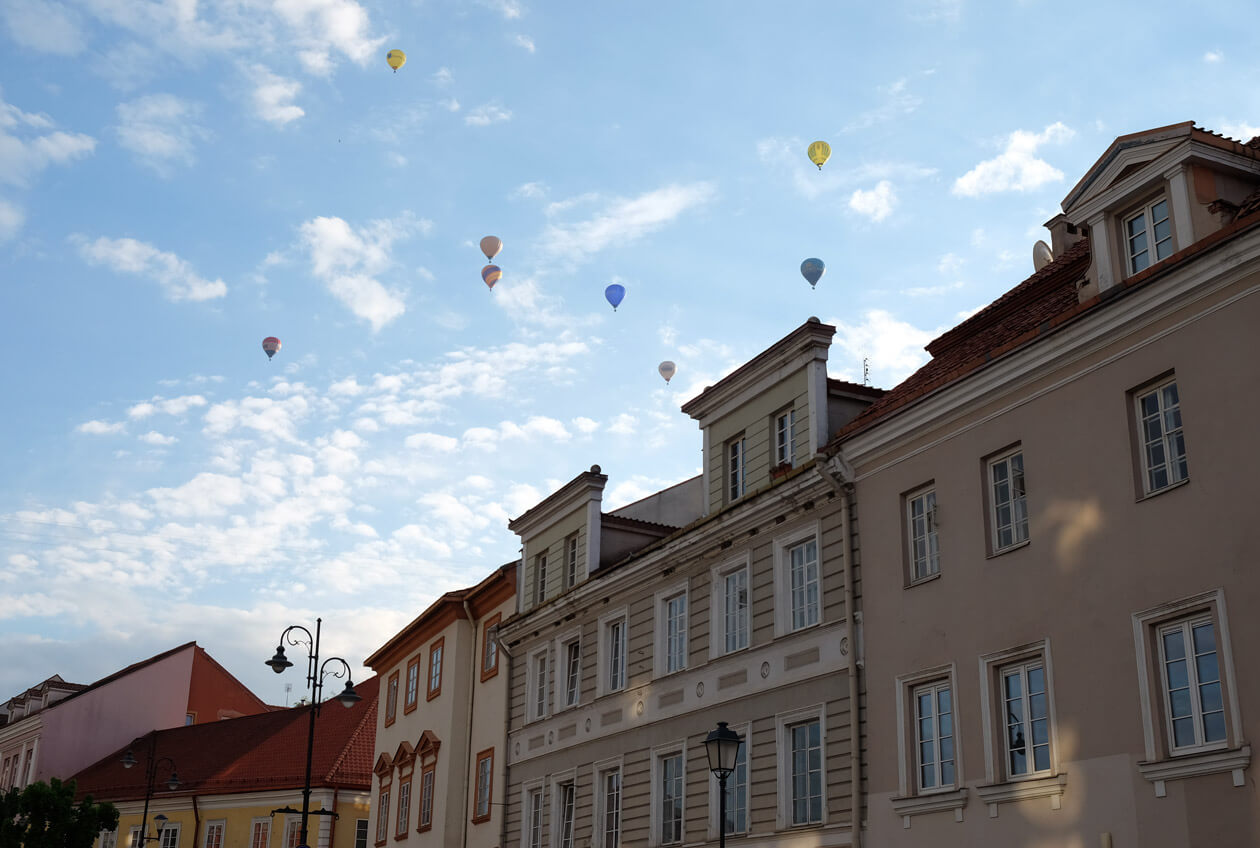 Hot air balloons gliding over Vilnius's old town