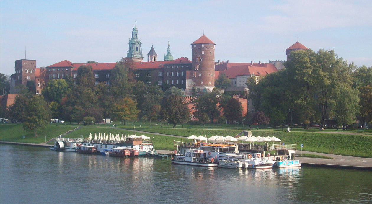 Strolling around the Vistula river in Krakow, Poland, with magnificent views of Wawel Castle