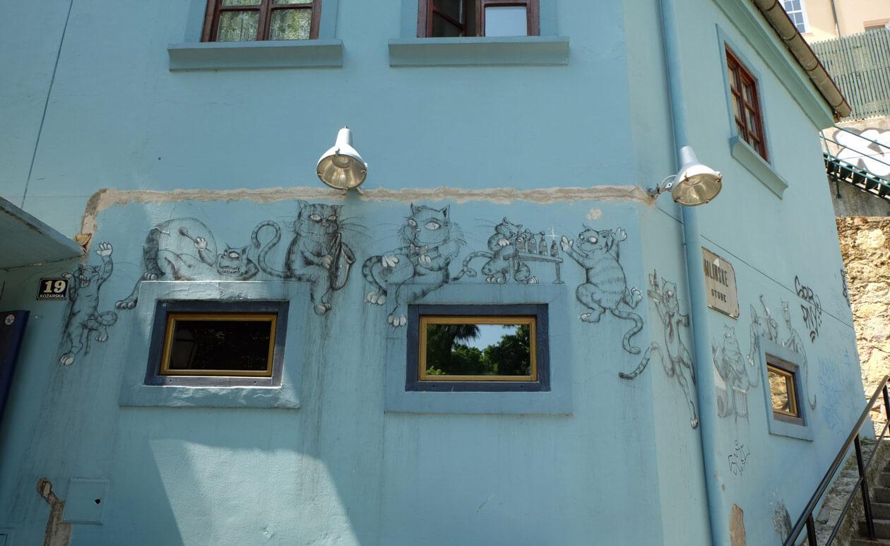 Street art of cats on a cafe's wall on Tkalčićeva Street