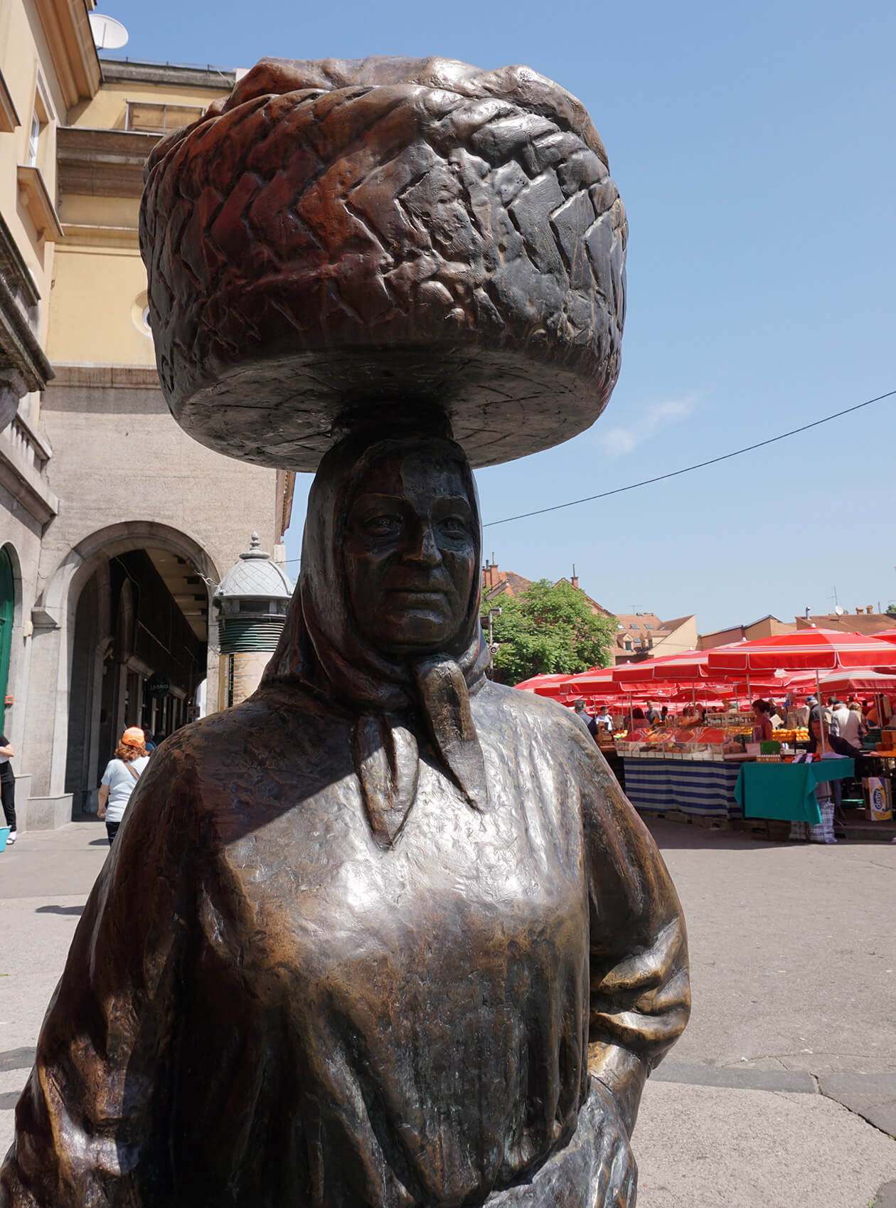 A statue of a market trader in Dolac market, Zagreb