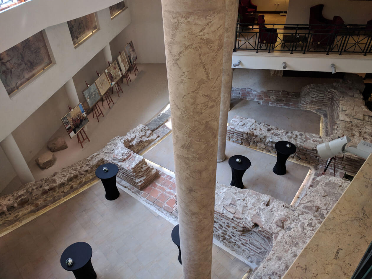 The Roman amphitheatre hidden inside a modern hotel