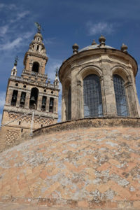 The dome of one of the cathedral's chapels and the Giralda bell tower