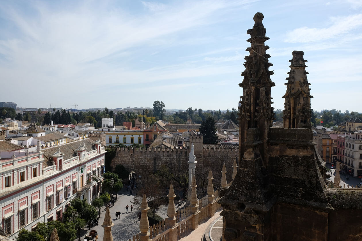 Looking down at the walls of the Real Alcazar palace and gardens on our Seville cathedral rooftop tour