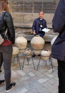 Our guide showing us examples of the terracotta pots which were used to fill the roof cavities