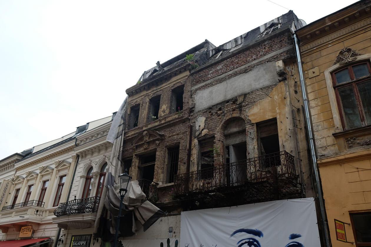 In Bucharest's historic centre, derelict buildings are next door to newly restored ones