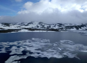 Crossing the stunning Hardangervidda plateau. Even in June it's covered in snow and ice.