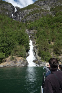 The boat slowed and got up close to this waterfall in the Nærøyfjord