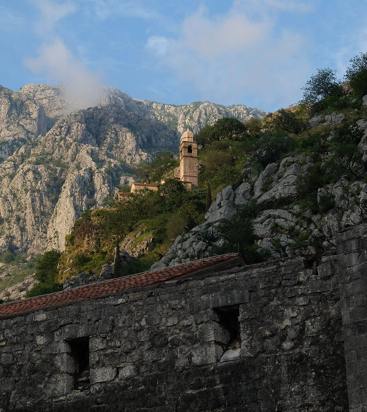 Kotor city walls and church in the evening sunshine