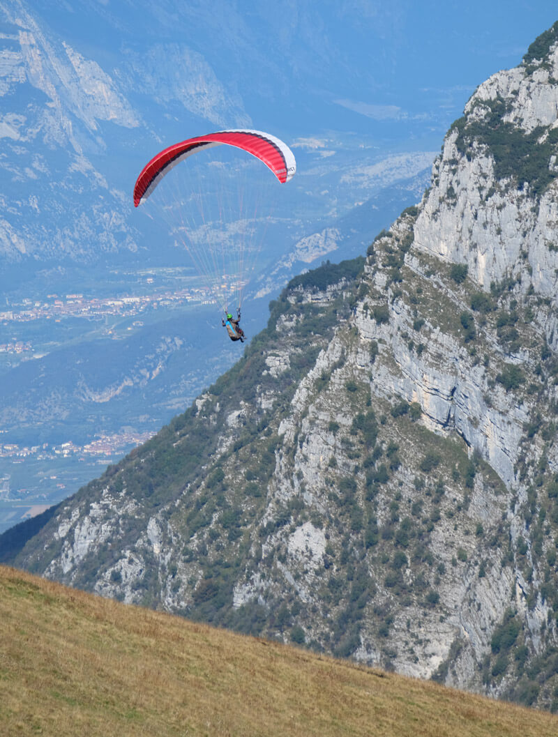A paraglider launching themselves from the top of Monte Baldo