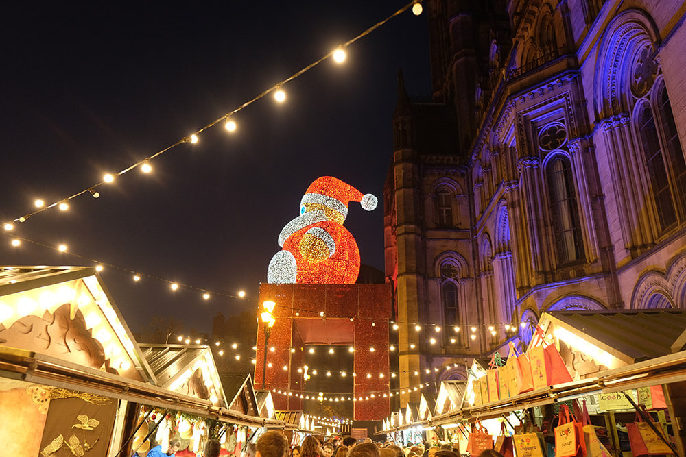 A huge Santa presides over the Manchester Christmas Market in Albert Square