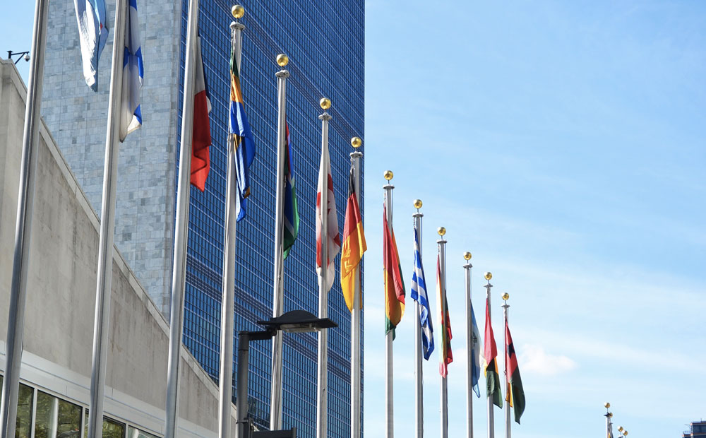 Flags of the world outside the United Nations building in New York
