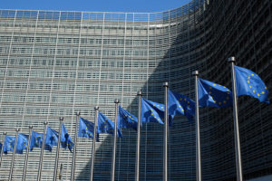 European Union flags outside the Berlaymont Building in Brussels