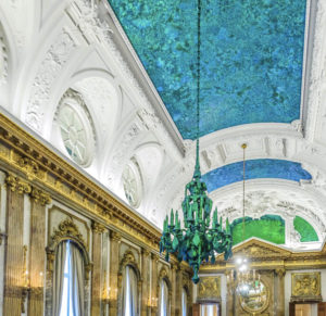 The ceiling and chandeliers in the Royal Palace's Mirror Room are covered in millions of iridescent beetles