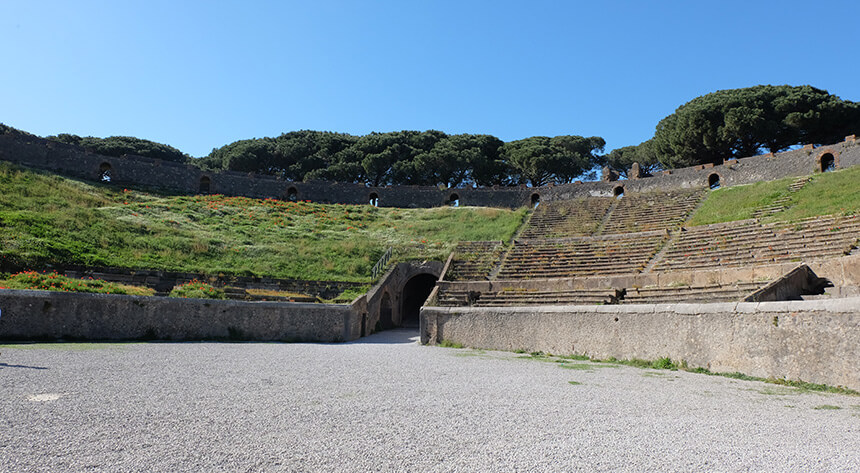 The large amphitheatre at Pompeii is the oldest surviving Roman amphitheatre in the world. It's located at the far end of the site, a mile from the main gate and the Forum.