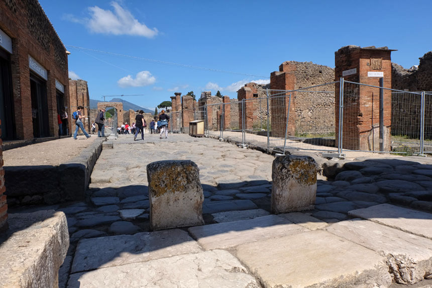 The cafe inside the Pompeii ruins (on the extreme left in this picture) serves drinks, coffee, sandwiches, pizza slices, salads and other snacks. It's located behind the Forum.