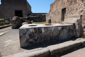A shop counter in Pompeii. Our tour guide explained to us how people in Pompeii often bought their food from these ancient takeaways