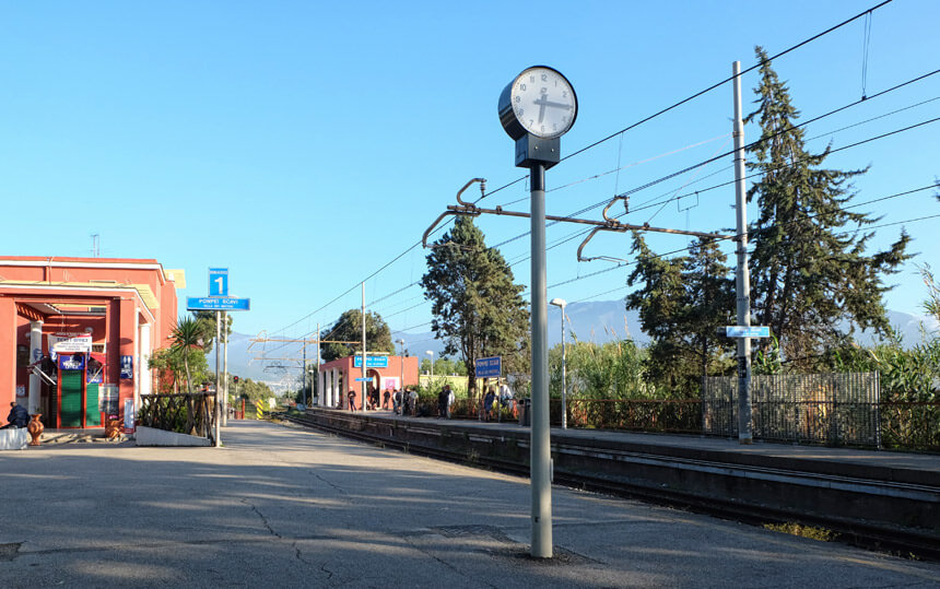 Pompei Scavi train station on the Circumvesuviana railway line between Naples and Sorrento. Taking the train is an easy way to visit Pompeii.