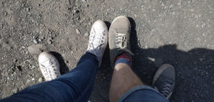 Our shoes covered in red dust after climbing up to the crater on Mount Vesuvius
