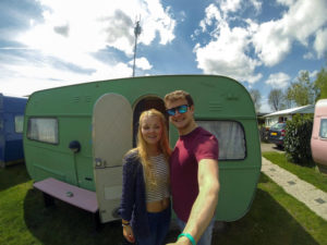 Gemma and her other half outside their caravan in Amsterdam on her 21st birthday