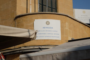 A sign on the Greek side describing Nicosia as the world's last divided capital city