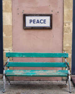 This little bench is just before the border crossing on the Greek side of the Green Line. The mosaic above says Peace - while the wall behind is dotted with bullet holes.