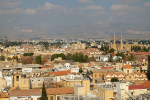 The view across North Nicosia from Shacolas Tower in the south. You can see the North Cyprus flag on the mountainside in the background.