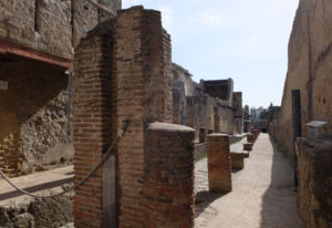 A street in Herculaneum. The buildings here are much better preserved than those in Pompeii