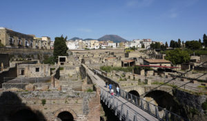 The ancient Roman city of Herculaneum, with Mount Vesuvius, the volcano which destroyed it, in the background