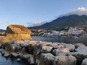 The Fungo mushroom rock in Lacco Ameno, with Monte Epomeo in the background