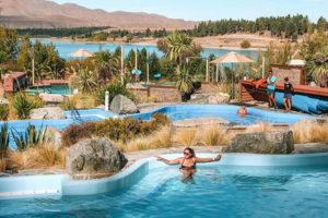 Relax in one of the three hot spring pools at Tekapo Springs with a view of UNESCO-listed Lake Tekapo