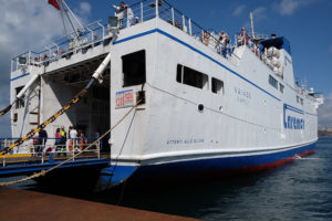 A Caremar ferry from Ischia docked at Marina Grande on Procida