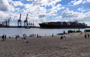Sitting at the beach watching the container ships, near the Neumühlen/Övelgönne ferry stop