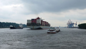 Following a giant container ship down the Elbe on Hamburg's number 62 ferry