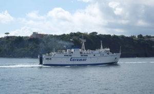 A Caremar ferry to Ischia passing Procida