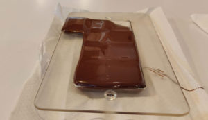 Step one. A freshly-poured bar of dark chocolate, ready to decorate.