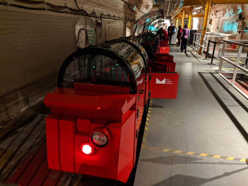 Climb inside the miniature carriages of the Mail Rail for an unforgettable journey below London