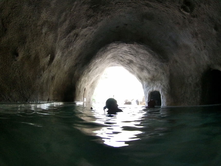 The Onphalos pool is in a cave and is the temperature of a gentlly warm bath for ultimate relaxation