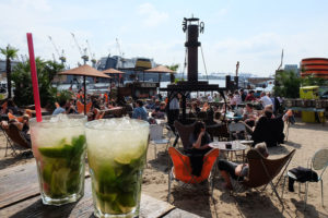 The Strandpauli beach bar is a great place to relax with a cocktail and watch the giant container ships glide past