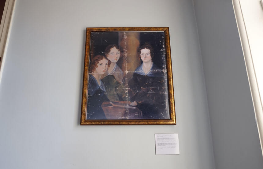 Branwell Brontë's famous portrait of his sisters (left to right) Anne, Emily and Charlotte. You can clearly see where he painted his own face out of the picture.