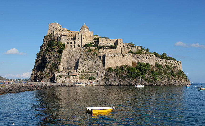Castello Aragonese sits at the end of a long causeway in the village of Ischia Ponte