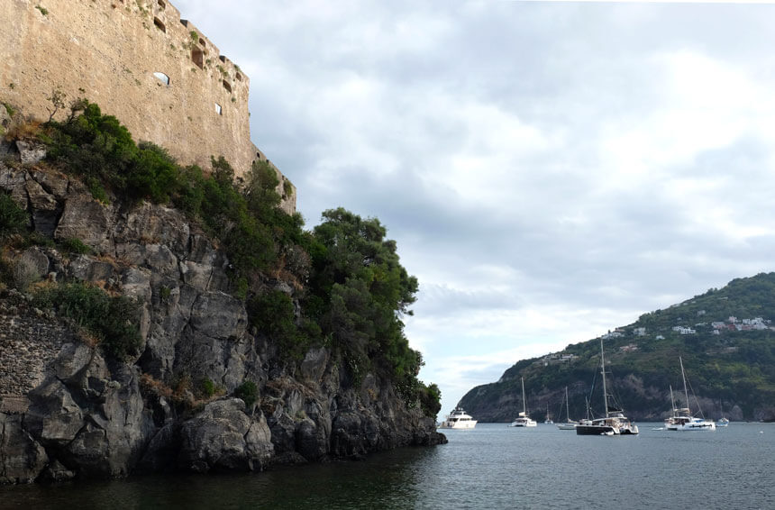 Looking up at the castle walls from the bridge that links it to Ischia Ponte
