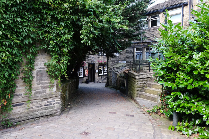 Church Street in Haworth. Most roads in the village are very narrow.