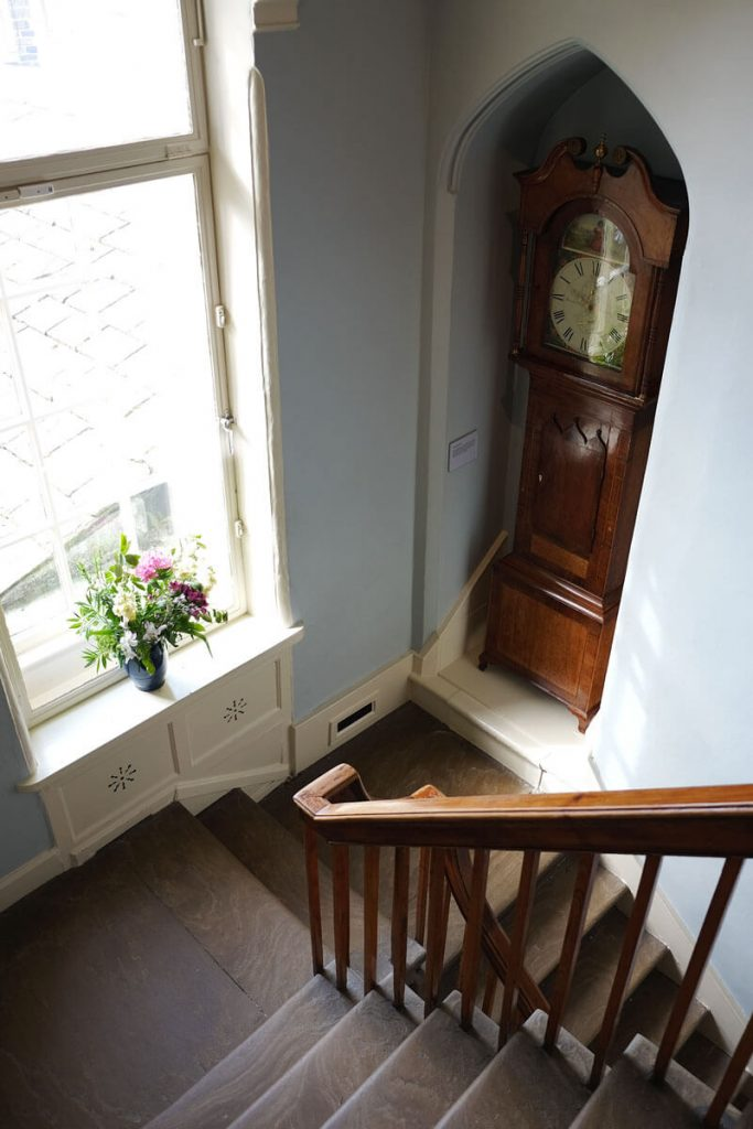 The grandfather clock on the stairs