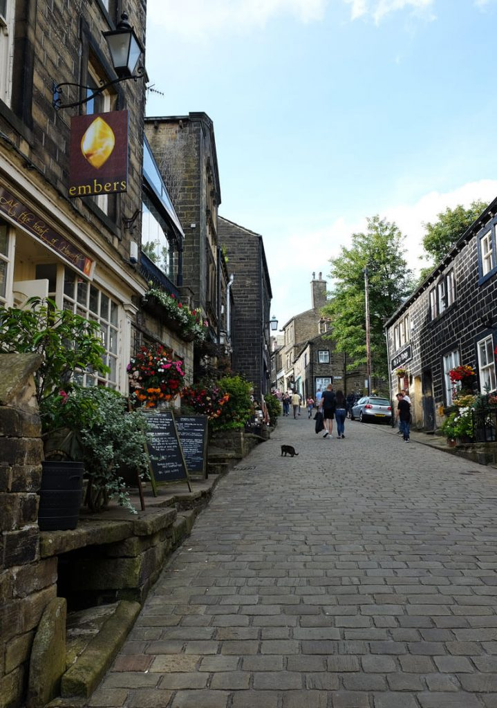 Looking up Haworth Main Street. The railway station is at the bottom of the hill, while the Brontë Parsonage Museum is at the top. Luckily there are plenty of inviting pubs and tea rooms on the way.